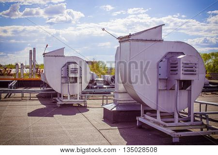 ventilation pipes on a roof. industrial ventilation system on the roof
