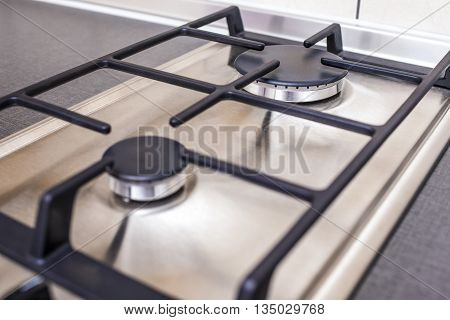 Closeup of Modern Double Burners Split Gas Oven. Horizontal Image Orientation