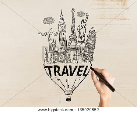 Travel concept with male hand drawing sketch on light textured background