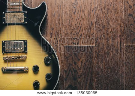 Electric Guitar On Brown Surface