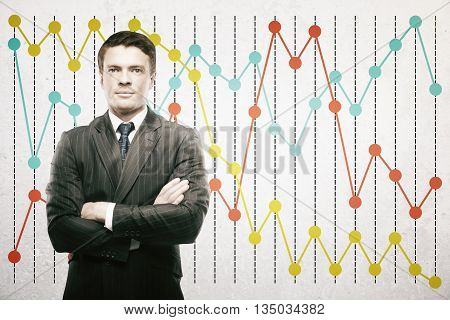 Confident businessman on colorful business chart background
