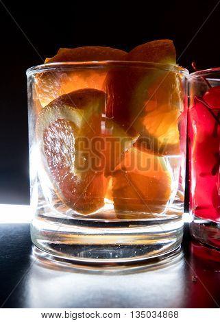 Oranges for Drinks Backlit on a bar top