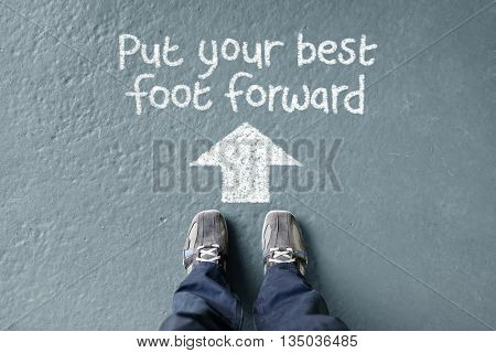 Put your best foot forward man standing with direction arrow to move forward