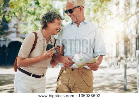 Retired Couple Walking Around The Town
