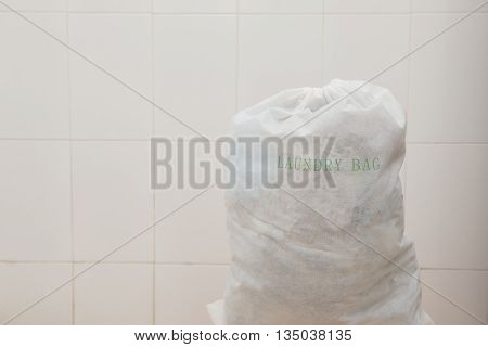 Laundry bag containing dirty washing with copy space