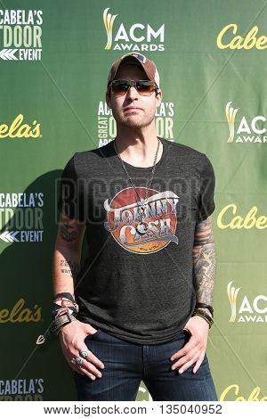 ARLINGTON, TX - APR 18: Recording artist Austin Webb attends the ACM & Cabela's Great Outdoor Archery Event at the Texas Rangers Youth Ballpark on April 18, 2015.