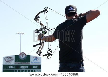 ARLINGTON, TX - APR 18: Recording artist Luke Bryan paticipates at the ACM & Cabela's Great Outdoor Archery Event at the Texas Rangers Youth Ballpark on April 18, 2015.