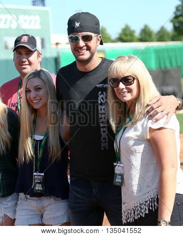 ARLINGTON, TX - APR 18: Luke Bryan (C) poses with fans at the ACM & Cabela's Great Outdoor Archery Event at the Texas Rangers Youth Ballpark on April 18, 2015.
