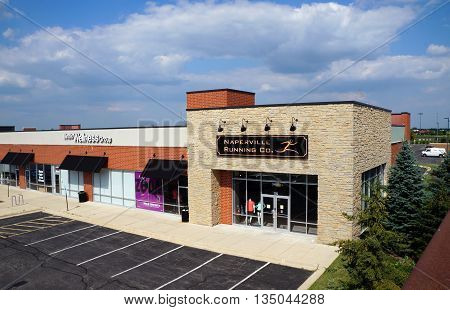 NAPERVILLE, ILLINOIS / UNITED STATES - JULY 23, 2015: The Naperville Running Company sells running shoes in a Naperville strip mall.