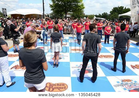 ARLINGTON, TX - APR 18:Celebrities stand on the checkerboard at the Cracker Barrel Old Country Store Country Checkers Challenge at Globe Life Park in Arlington on April 18, 2015 in Arlington, Texas.
