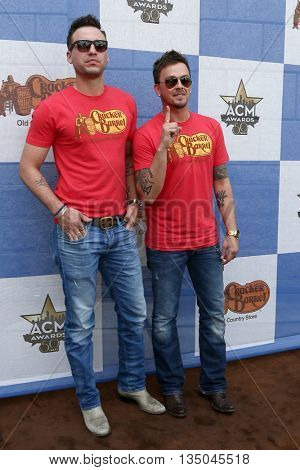 ARLINGTON, TX - APR 18:Eric Gunderson (L) & Stephen Barker Liles of Love & Theft at the Cracker Barrel Country Checkers Challenge at Globe Life Park in Arlington on April 18, 2015 in Arlington, Texas.