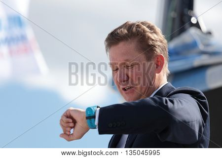 ST. PETERSBURG, RUSSIA - JUNE 4, 2016: Chairman of the Management Committee of Gazprom Alexey Miller looking to the watch showing the time of the Nord Stream Race. Five teams compete in the race