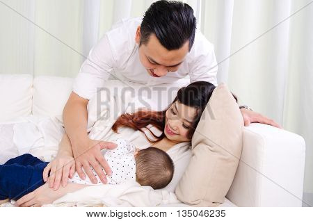 Asian woman breastfeeding her six months old baby boy