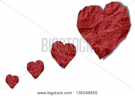 Red crumpled paper hearts shape floating on, isolated on white background