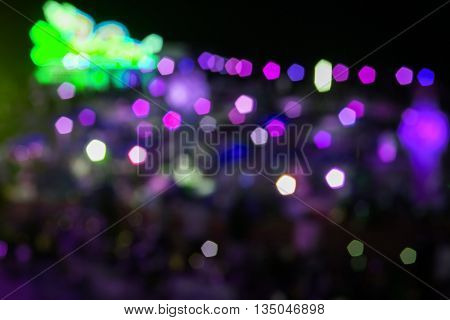 Abstract green and violet night lights with blurred background