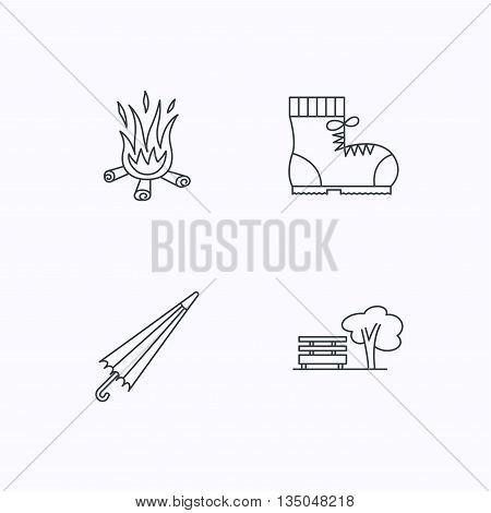 Bonfire, umbrella and hiking boots icons. Park linear sign. Flat linear icons on white background. Vector