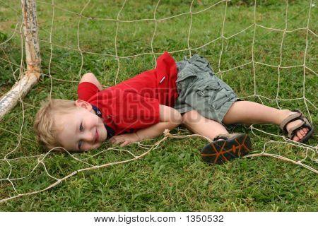 Toddler Boy Playing Goalie In Soccer Goal