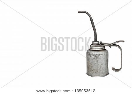 Old and dirty metal oil can isolated on white background