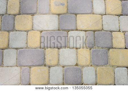 The Texture Of Masonry Pedestrian Bridge. Colored Stones