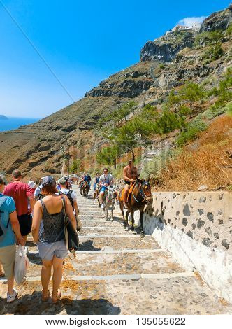 Santorini, Greece - June 10, 2015: The road to the sea from the steps and traditional transport in the form of a donkey