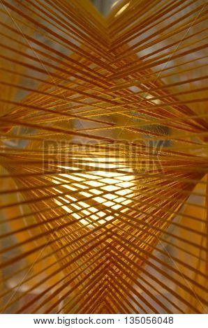 Abstract of various strings with yellow lighting