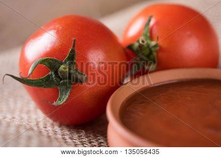 Tomato cream or puree in a ceramic bowl, Tomato sauce with fresh tomatos