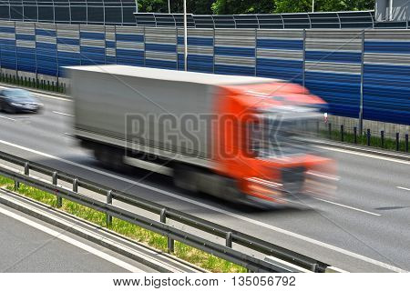 Large Goods Vehicle Moving At Full Speed On Six Lane Highway