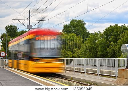 Streetcar entering the tram stop. Mass transit