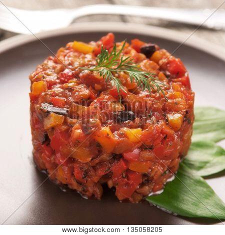 Vegetable stew in a brown plate closeup. Vegetarian healthy food