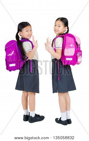 Portrait of asian primary students waive their hands