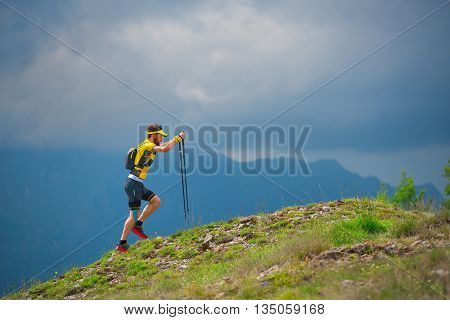 Man Alone Walking In The Mountains