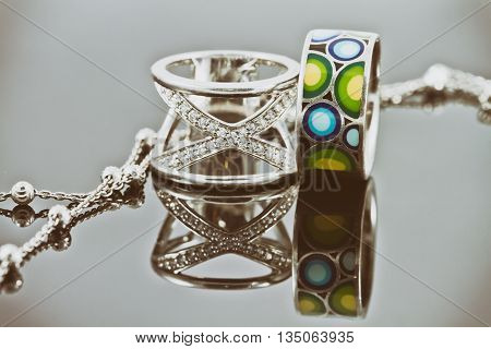 Silver Rings Of Various Shapes And Silver Chain