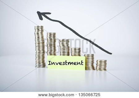 investment financial concept with moving up coins stacks graph