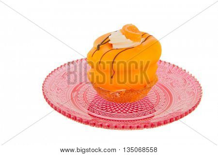 Yellow pastry on pink glass plate