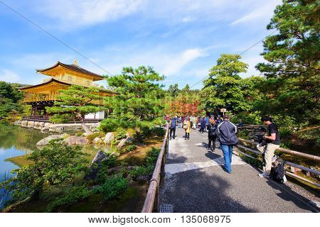 KYOTO JAPAN - NOVEMBER 12 2015: Unidentified people visit Kinkakuji Temple (The Golden Pavilion) at autumn. Here is one of the most famous landmarks in Kyoto