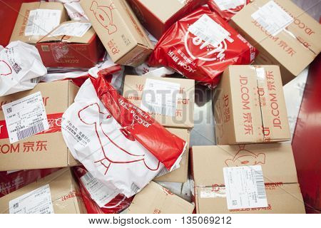 Gu'an, China - June 14, 2016: JD.com packages awaiting sorting at Northeast China based Gu'an distribution facility Gu'an, China