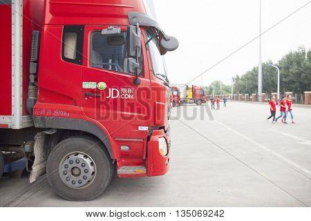 Gu'an, China - June 14, 2016: JD.com truck receiving incoming goods and preparing shipments at the Northeast China based Gu'an warehouse and distribution facility, Gu'an, China