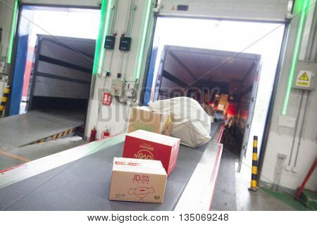 Gu'an, China - June 14, 2016: JD.com packages awaiting distribution by truck at Northeast China based Gu'an distribution facility Gu'an, China