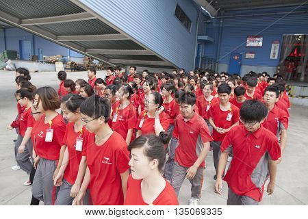 Gu'an, _China - June 14, 2016: JD.com staff setting out to work at Northeast China based Gu'an warehouse and distribution facility