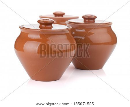 Three clay pots. Isolated on white background
