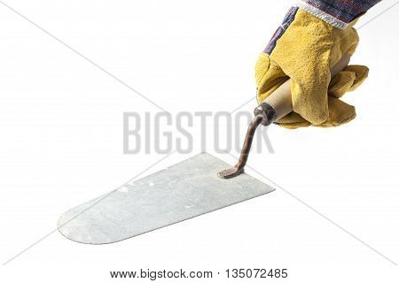 Worker's hand in protection glove with a trowel on white background.