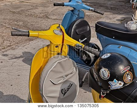 FORLIMPOPOLI FC ITALY - JUNE 19: yellow classic scooter Vespa with spare wheel cover parked during the italian scooter rally