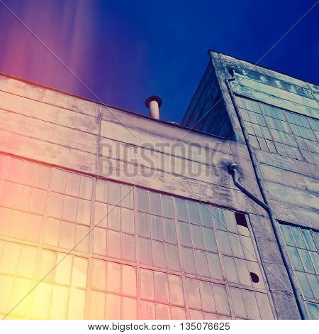 old industrial building fragment sunny day blue gray