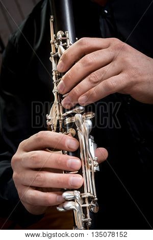 hands of a clarinet player in black