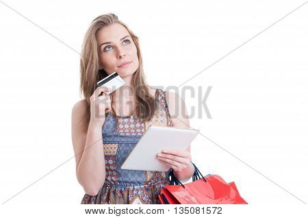 Pensive Gorgeous Lady With Credit Card And Modern Tablet