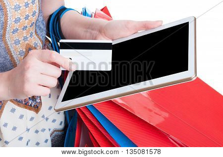 Online Payment Concept With Tablet And Debit Card In Close-up
