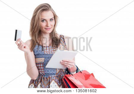 Beautiful Smiling Shopper Holding Tablet And Card Doing Shopping Online