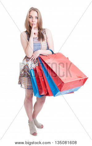 Full Body Of Young Stylish Shopaholic With Shopping Bags Shushing