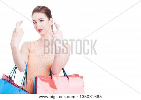 Lady Shopper Showing Fingers Crossed With Both Hands