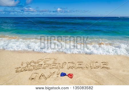 Happy Independence Day USA background with holidays bow on the sandy beach (4th of july holiday concept)